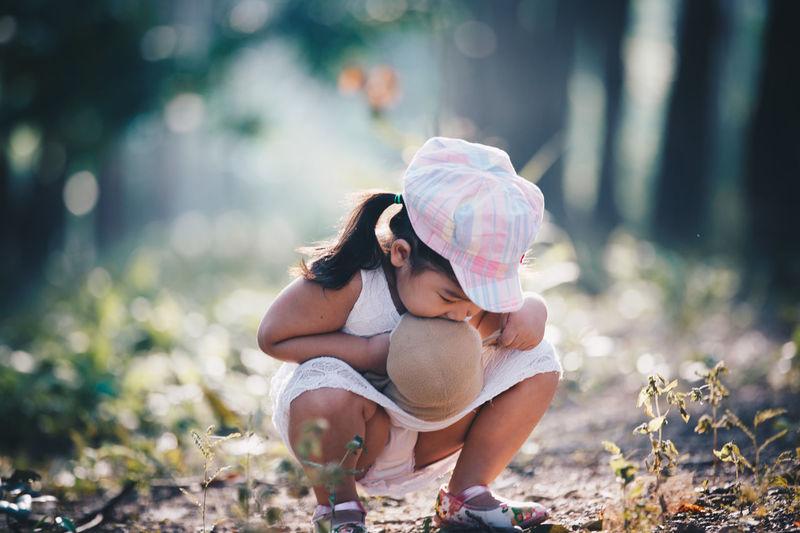 Girl crouching on field