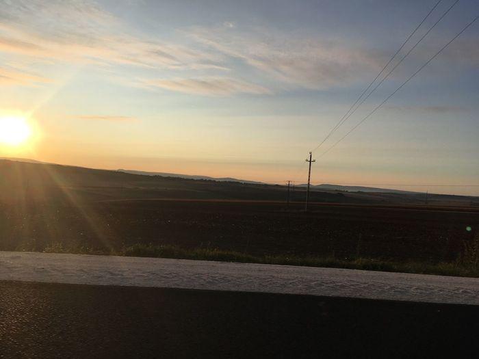 Dawn Sky Sunset Road Sun Beauty In Nature Cloud - Sky Sunlight Nature Sunbeam Landscape No People Orange Color Lens Flare