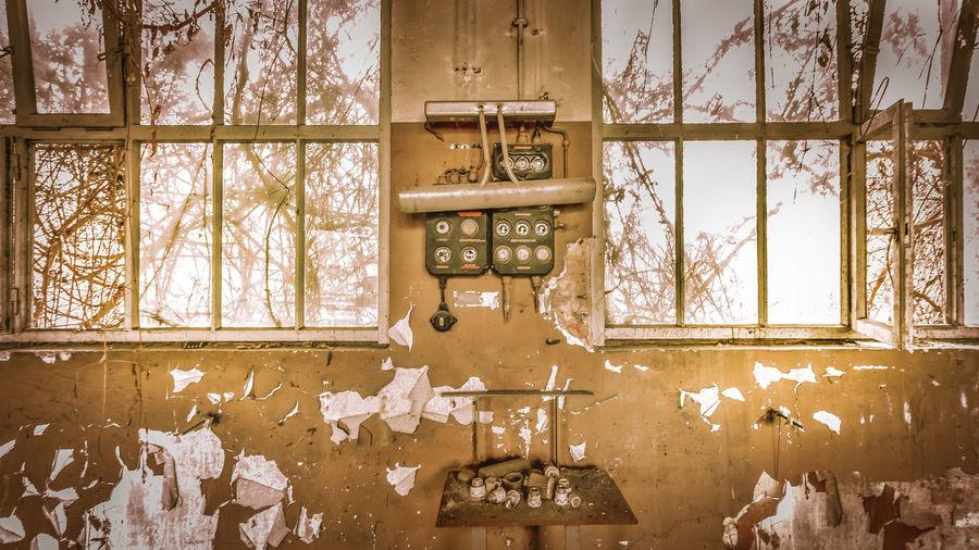Peeling wall and window of house