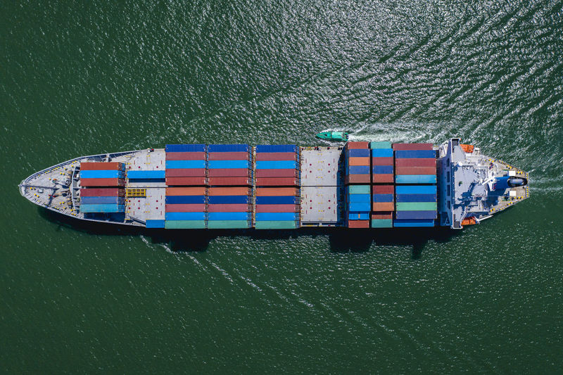 High angle view of containers ship import export international on green sea