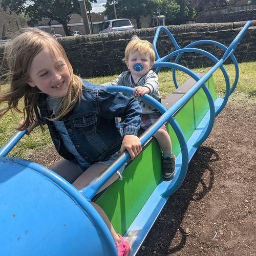 Happy girl on slide at playground