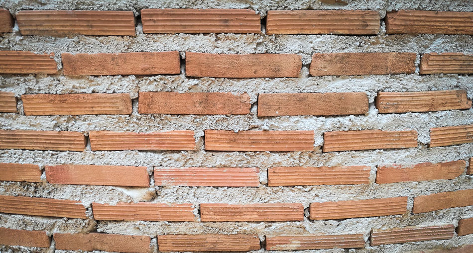 Architecture Arrangement Backgrounds Brick Brick Wall Brown Built Structure Close-up Day Full Frame In A Row Large Group Of Objects No People Outdoors Pattern Repetition Side By Side Textured  Wall Wall - Building Feature