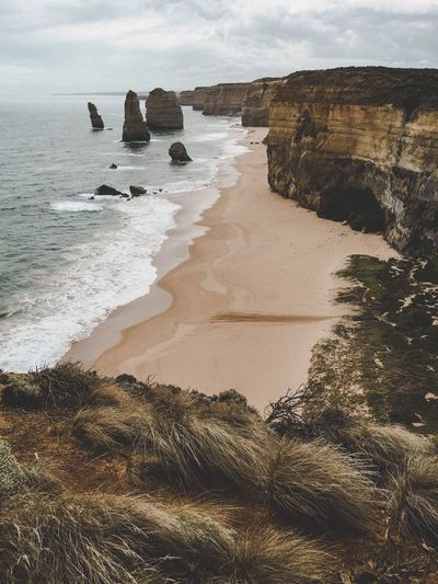 Ocean Sea Beauty In Nature Beach Nature Rock - Object Sand Rock Formation Scenics Tranquil Scene No People Tranquility Water Day Wave Outdoors Horizon Over Water Cliff Travel Destinations Sky