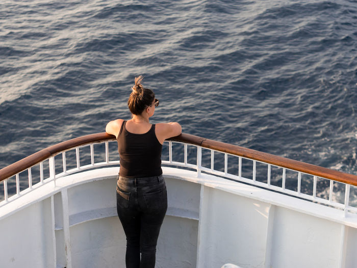 Woman on cruise ship fence looking at the blue sea Water Sea Rear View Standing One Person Nature Leisure Activity Transportation Day High Angle View Nautical Vessel Holiday Motion Travel Outdoors Hairstyle Woman Summer Travel Croatia Adriatic Sea Mediterranean  Europe Cruise Ship