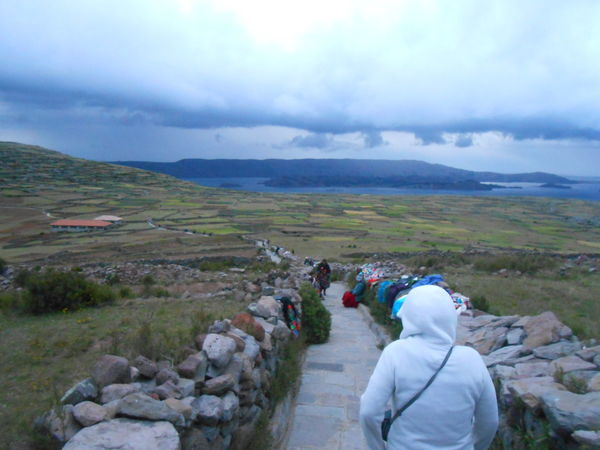 Traveling Home For The Holidays Cloud - Sky Landscape Beauty In Nature Nature Outdoors Sky Cuming Down From A Sacred Mountain Clouds People Selling Handcrafts On The Way Rain To Start Amantani Island Titicaca Lake Environment 3.800 Mts. Hi.