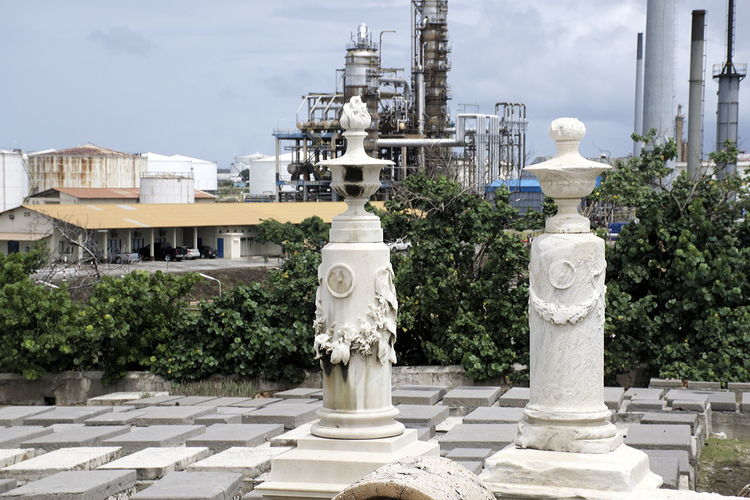 The ancient Jewish Cemetery Beth Haim with the Curoil refinery looming in the background Antique Architecture Beth Haim Building Exterior Cemetery City Cityscape Curacao Curoil Day Historical Cemetery No People Outdoors Refinery Sky Urban Skyline Willemstad