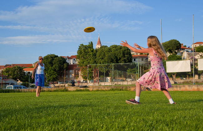 Brac Child Croatia Frisbee Girls Green Hrvatska Leisure Activity Mid-air Motion Outdoors Playing Postira Sport Throwing  Vaction Village Vitality