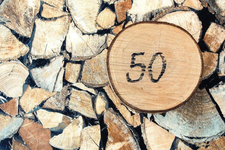 Close-up of number 50 on log