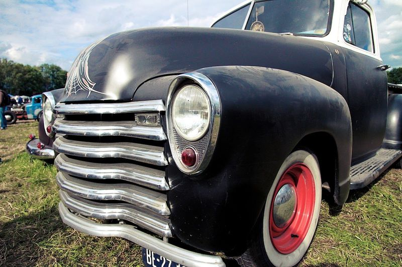 Close-up of vintage car on grass