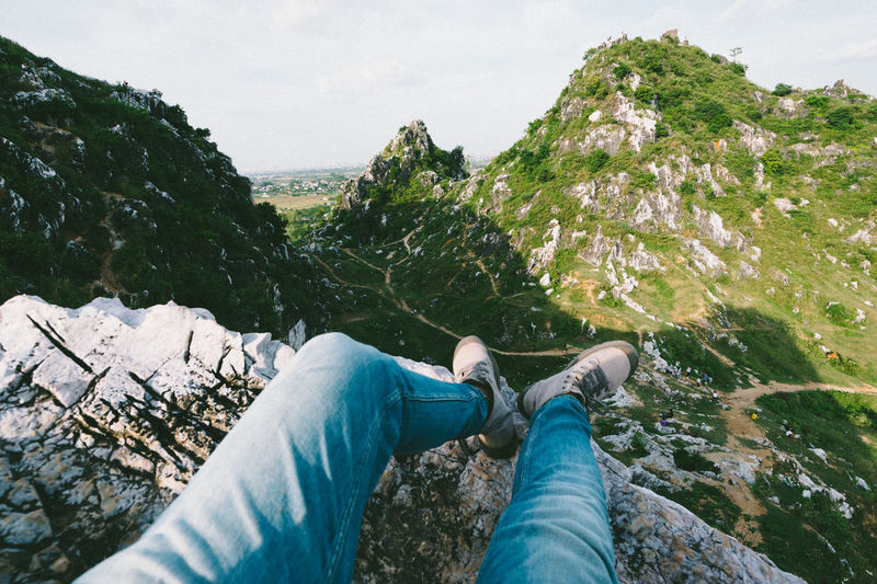 Me. Jean. Travel Boots Exploring Green Color Hà Nội Jeans Travel Trip Viet Nam Adventure Beauty In Nature Blue Close-up Day Human Leg Low Section Mountain Nature One Person Outdoors Personal Perspective Rock - Object Sitting Sky Sony Sonya7II