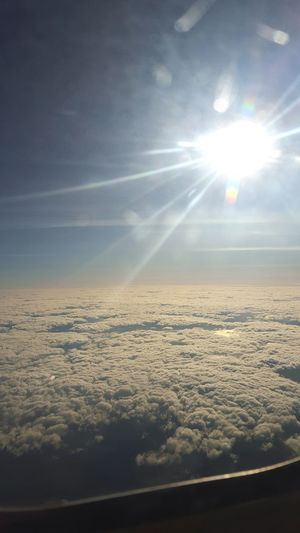 Sunlight Sun Sky Cloudscape Sunny Cloud - Sky Cloud The Natural WorldSunlight Nature Beauty In Nature Sunny Day Flying Flying In The Sky FlyHigh Fly White White Clouds Clouds And SkyOutdoors Day Over The Clouds Over The Ocean