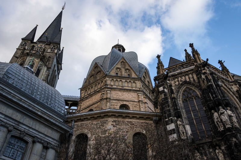 Aachen Cathedral Aachen Aachener Dom Aachen Cathedral Architecture Sky Built Structure Cloud - Sky Building Exterior Low Angle View Religion Place Of Worship Belief Spirituality History The Past Building Travel Destinations Travel Day No People Spire  Ornate Germany Deutschland