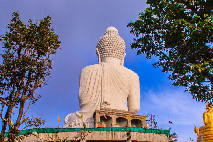 Amazing Massive white marble Buddha statue, the famous tourist attraction on top of hill in Phuket, Thailand. Big Buddha Marble Statue Massive Stone Buddha Architecture Art And Craft Big Buddha Temple Big Buddha Statue Big Buddha, Thailand Building Exterior Built Structure Clear Sky Day Giant Buddha Human Representation Low Angle View Male Likeness Marble Buddha Marble Stone Nature No People Outdoors Religion Sculpture Sky Spirituality Statue Travel Destinations Tree Worship Places