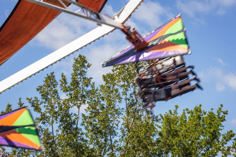 Carnival flight Carnival Ride Day Flight Flying In The Sky Fun Low Angle View Multi Colored Outdoors Tree