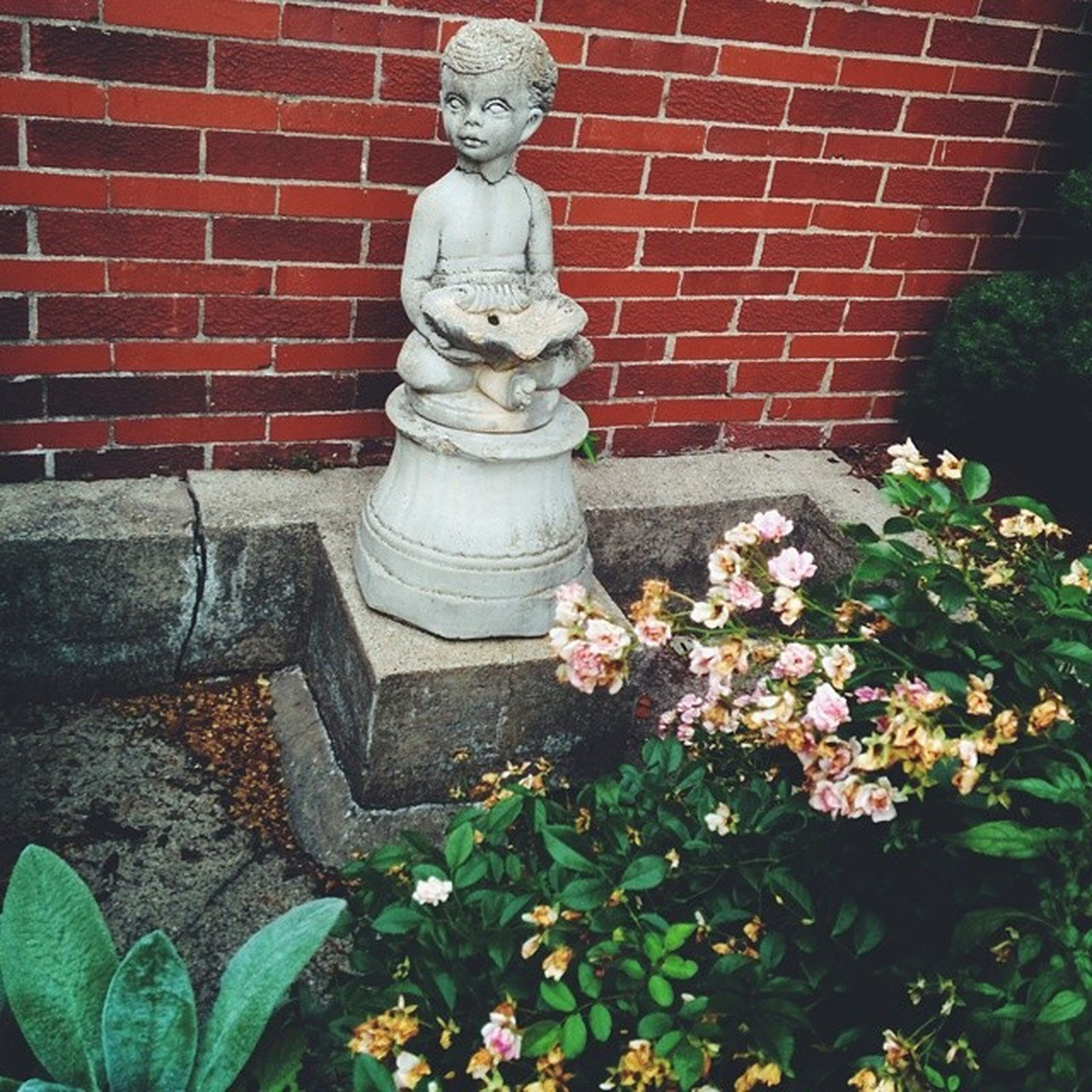 statue, human representation, sculpture, art and craft, art, flower, creativity, plant, built structure, architecture, building exterior, growth, stone material, day, carving - craft product, no people, outdoors, wall - building feature