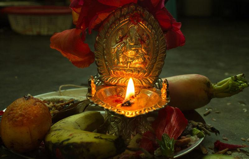 Ganesha Idol And Burning Diya In Plate