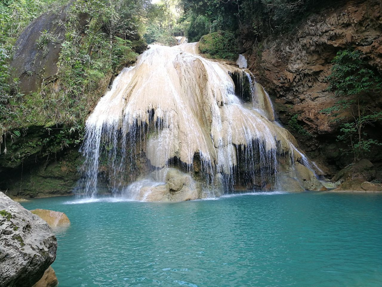 water, beauty in nature, waterfall, scenics - nature, motion, rock, rock - object, solid, flowing water, nature, rock formation, long exposure, waterfront, day, no people, non-urban scene, land, blurred motion, sea, outdoors, flowing, falling water, power in nature, turquoise colored, rainforest