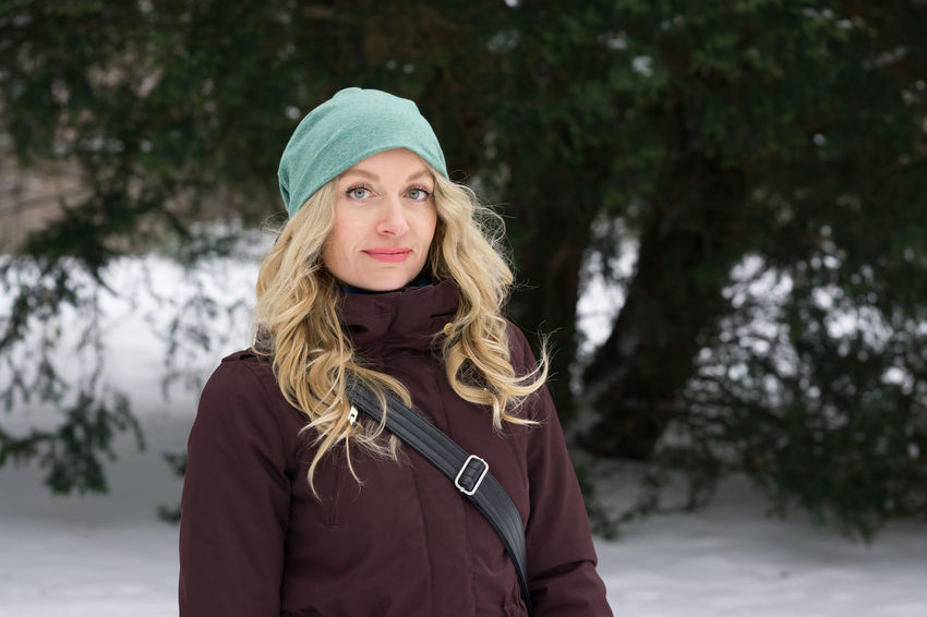 Adult Blonde Cold Temperature Fashion Knit Hat Long Hair Looking At Camera Nature One Person Outdoor Park People Portrait Snow Snow Covered Trees Warm Clothing Winter Woman