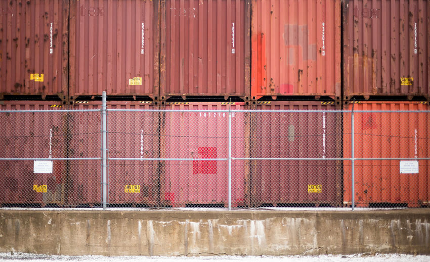 Cargo containers stacked at shipyard