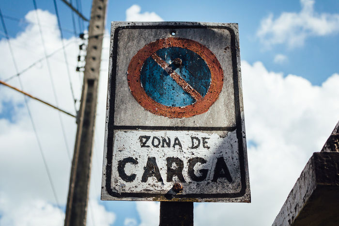 Alertness Communication Cuba Collection Cuban Life Deterioration Forbidden Forbidden Places Loading Zone Low Angle View No People Old Sign Outdoors Road Rusty Sign Sky Text