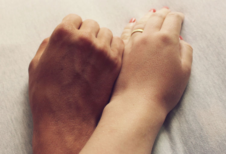 Extreme close up of couple hands