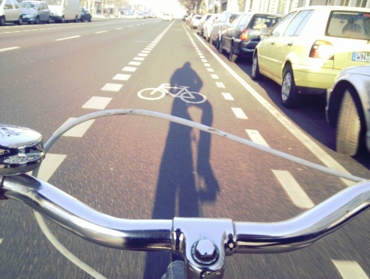 Cropped image of bicycle on road