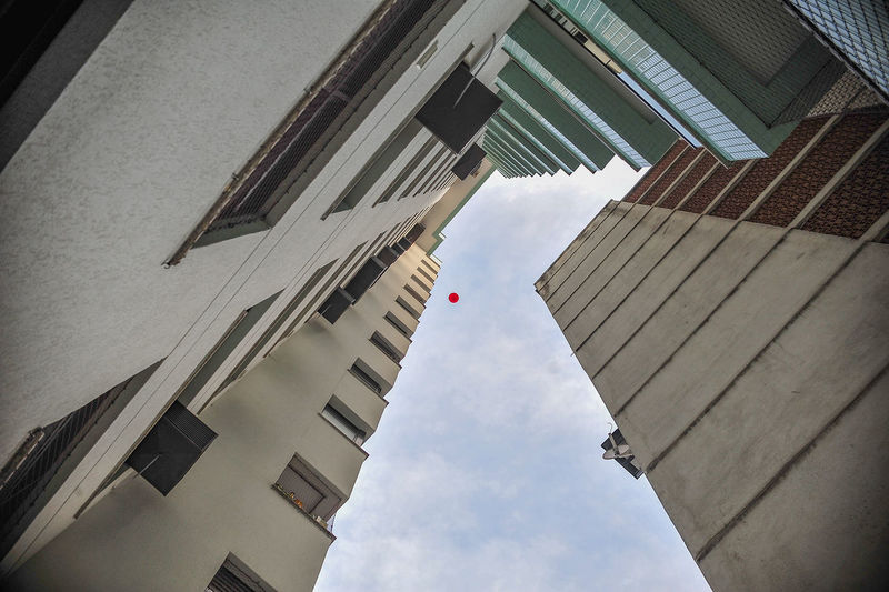 Low Angle View Of Balloon Amidst Skyscrapers Against Sky