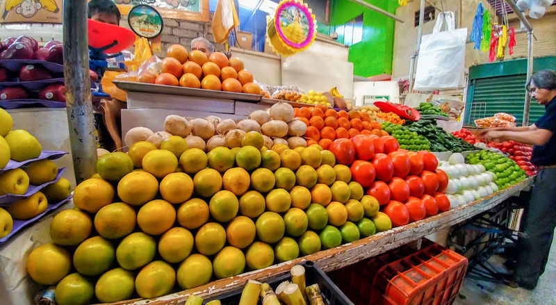 Abundance Arrangement Choice Customer  Day Food Food And Drink For Sale Freshness Fruit Healthy Eating Human Body Part Human Hand Large Group Of Objects Market Market Stall Mexico Multi Colored One Person Outdoors People Price Tag Real People Retail  Variation Food Stories