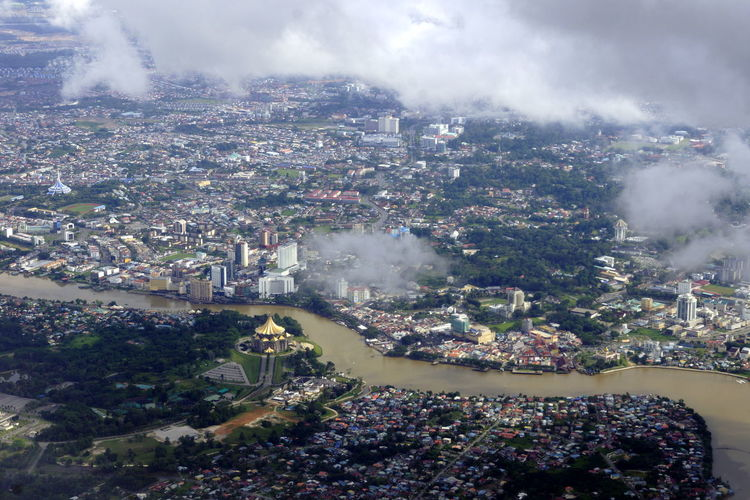 Aerial view of river amidst city