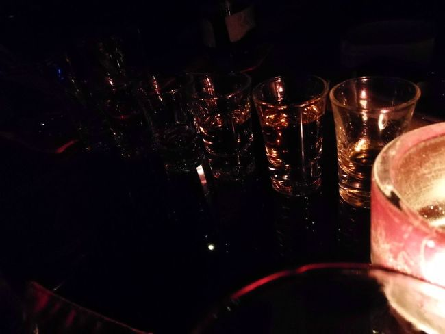 In the dark Alcohol Wine Drink Refreshment Wine Bottle Wineglass Indoors  No People Drinking Glass Red Bar - Drink Establishment Close-up Day