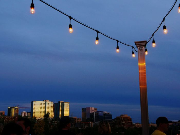 Scene from a bar in Denver. Check This Out Hanging Out Relaxing Eyeemphoto Dusk In The City Blue Color Urban Landscape Bar Scene Restaurant Scene Denver Colorado  Blue Sky Summer Activity Lights Atmosphere Social Gathering Been There.