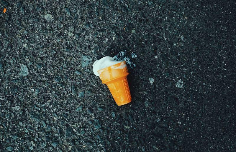Close-up of ice cream on ground