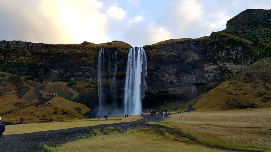 Iceland Seljalandsfoss Travel Vacations Holiday Waterfall Nature Beauty In NatureField Landscape Outdoors Environment Hills Mountain ScenicsCountryside Grass Sky Sunlight Peaceful Travel Destinations Autumn Golden Spraying Ice And Fire Breathing Space Investing In Quality Of Life The Week On EyeEm Your Ticket To Europe