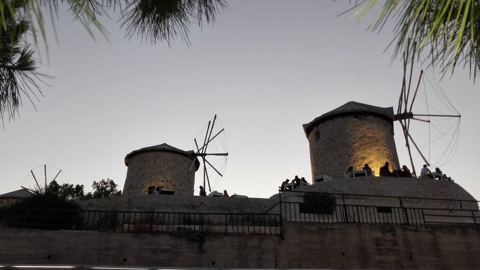 People Alaçatısokakları Architecture Build Construction Into The Night Mill Old Mill  Outdoors Sunset