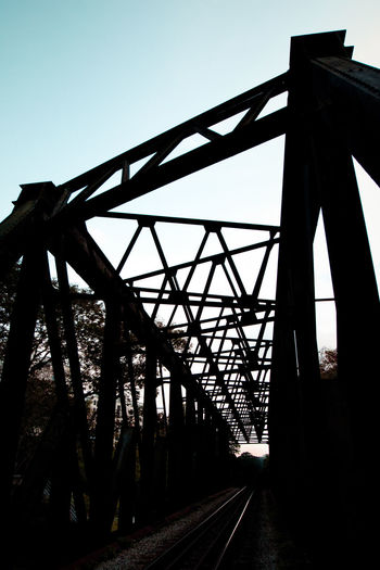 Architecture Beams Blue Bridge - Man Made Structure Built Structure Clear Sky Day Diminishing Perspective Interlace TakeoverContrast Metal Bridge No People Outdoors Railroad Bridge Silhouette Sky Surface Level The Way Forward Transportation Vanishing Point