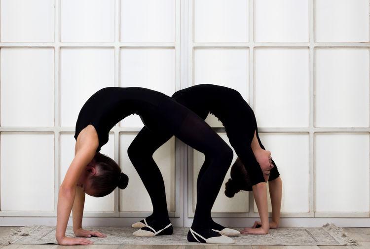 Side View Of Females Bending Over Backwards