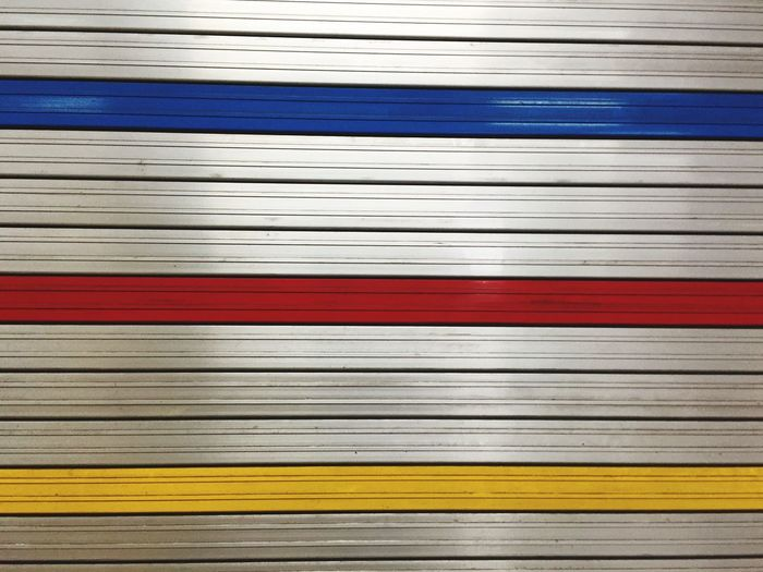 Backgrounds Full Frame Stack No People Close-up Indoors  Day Silver  Blue Red Yellow Wall Shop