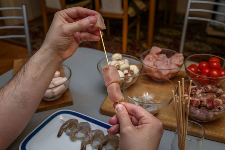 Midsection of person preparing food on table