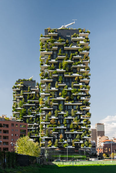 """""""Bosco Verticale"""" is a pair of two residential towers in the district of Porta Nuova, Milan; they host hundreds of trees and plants in the balconies Skyscraper Milan Milano Palace Building Exterior Vertical Urban Skyline City Cityscape Detail Close-up Architecture Exterior Façade Plants Green Sky Sunny Lombardia Lombardy Italy Modern Built Structure Outdoors"""