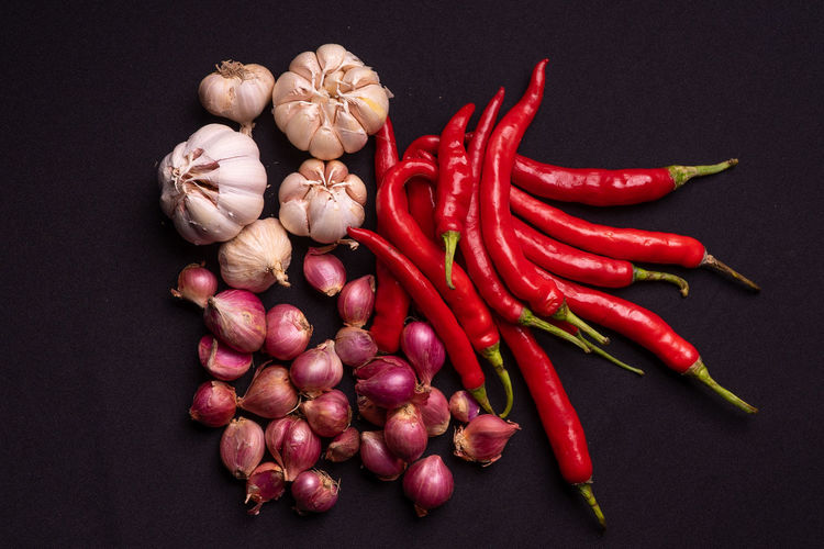 High angle view of red chili peppers on black background