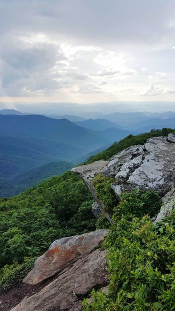 Mountain View Mountain Range Vertical Composition Lush Green Mountains Lush Foliage Landscape Scerenity Scenic Vista Cliff Rock Relaxation Beauty In Nature Clouds And Sky Beams Of Light Storm Clouds Weather Blue Ridge Mountains North Carolina Non Urban Scene