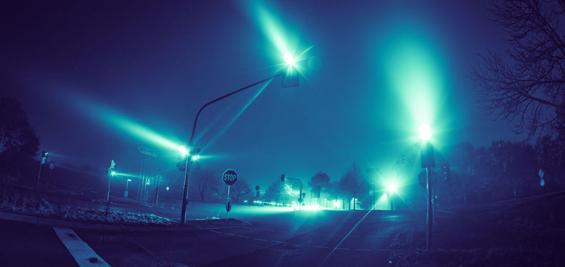 Night Illuminated Lighting Equipment Light Beam Street Light Street Architecture Light No People Lens Flare Light - Natural Phenomenon Glowing Road Outdoors Tree City Electrical Equipment Nightlife Crossroad Foggy Edit Fisheye Lens Traffic Lights Green Light Blue