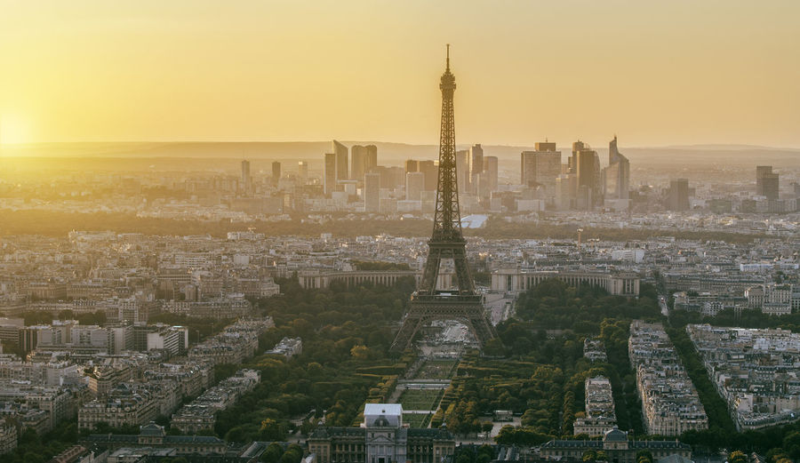 Aerial view of eiffel tower in city during sunset