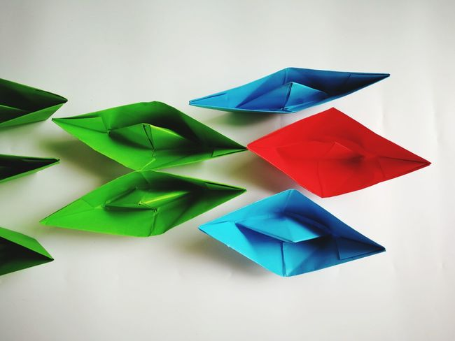 paper boats Multi Colored Studio Shot Triangle Shape Close-up Green Color Paper Boat Colored Pencil Geometric Shape Repetition In A Row Pencil Shavings Arrangement Cube Shape Origami Square Shape Art And Craft Equipment Rectangle LINE Shape Pencil Group Forestry Industry Order Triangle Five Objects Hexagon ArtWork