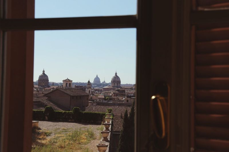 St peters basilica seen through glass window