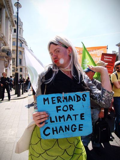 Going backwards on climate change protest. London, 08-05-2016 Today; 08-05-16 Protesters from the Campaign Against Climate Change (CACC) Staged a walking backwards protest alongWhitehall. London. Against governments backtracking on climate promises. Mermaid CACC Protesters Environment Climate Change Steve Merrick Campaign Against Climate Change Stevesevilempire Protest Zuiko Olympus London Britain