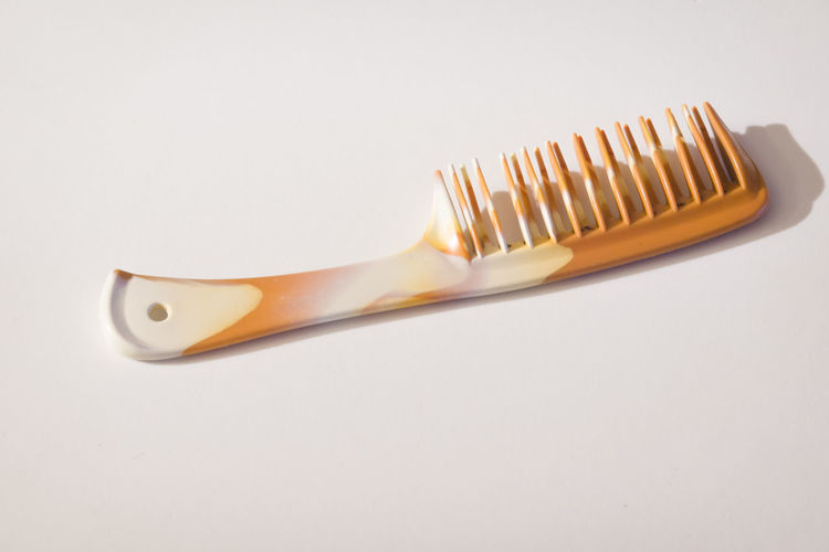 Close-up of fork over white background