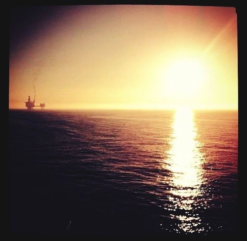 View from my work Horizon Over Water Sun Oilrig