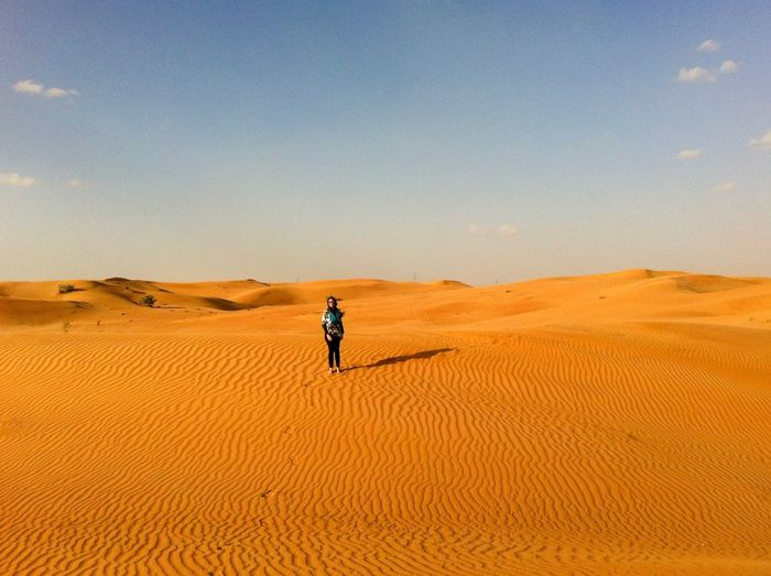 Alone in the dessert Land Desert Climate Sand Landscape Scenics - Nature Sand Dune Beauty In Nature Sky Arid Climate One Person Extreme Terrain Tranquil Scene Remote