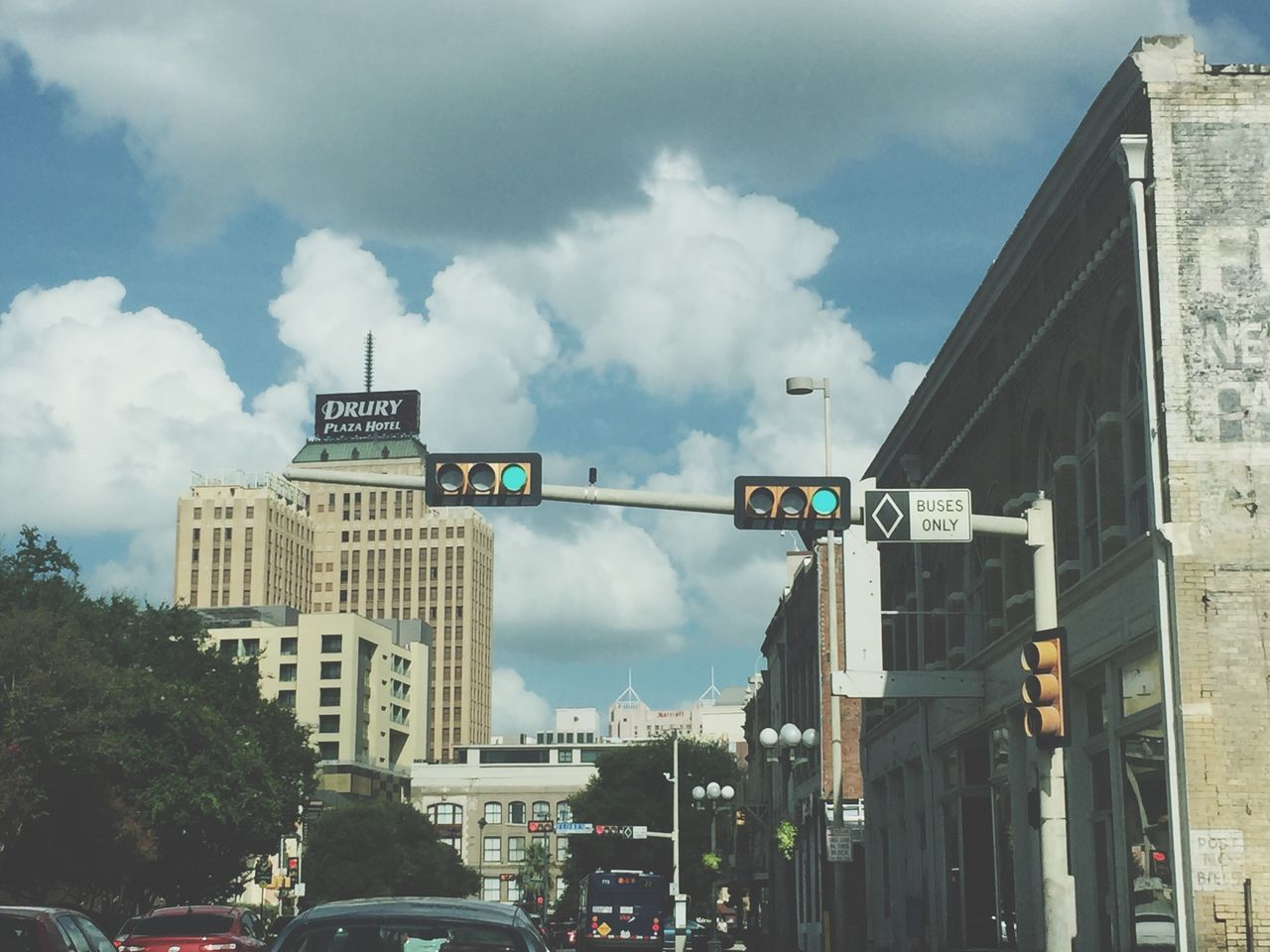 cloud - sky, architecture, sky, built structure, building exterior, day, city, outdoors, transportation, low angle view, no people, road